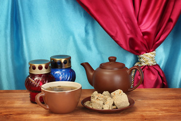 Teapot with cup and saucer with  sweet halva