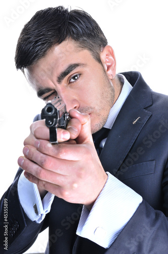 Man in a suit preparing to shoot. Isolated on white
