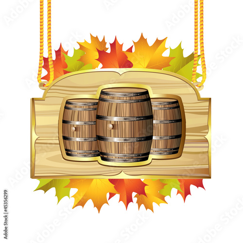 Wood barrel for wine with autumn colorful leaves