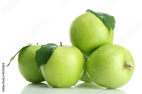 Ripe green apples with leaves  isolated on white