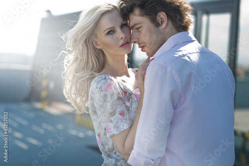 Young couple posing in urban scenery