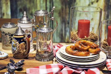 Decorative german beer steins and pretzels