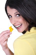 Woman with a tiny yellow toy duck