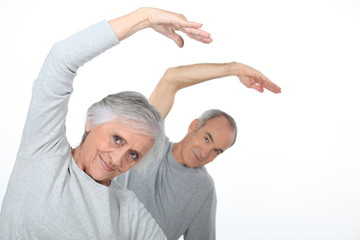Elderly couple warming up