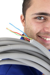 Tradesman carrying corrugated tubing