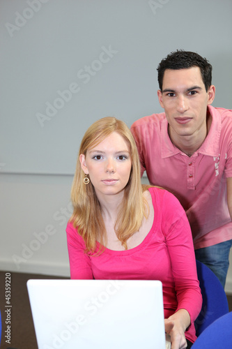 Teen couple with portable computer