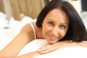 Brunette woman in bed