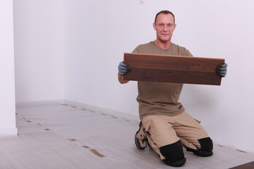Man laying parquet floor