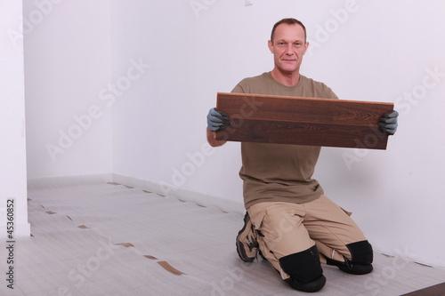Man laying parquet floor