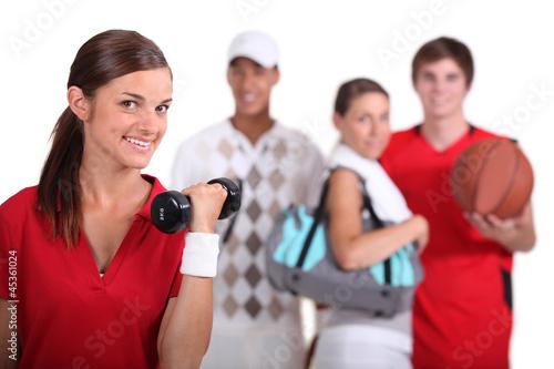 four teenagers loving sport