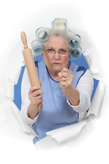Angry old woman with a rolling pin