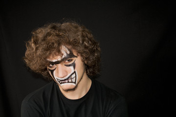 Halloween. Make-up on a face of the young man