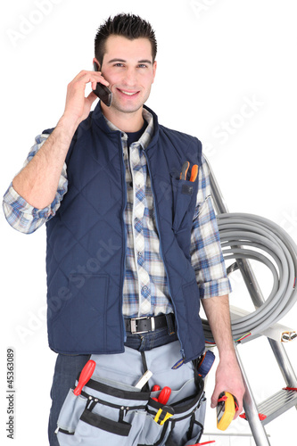 Electrician making call to supplier
