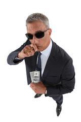 A crook holding stolen money and smoking a cigar