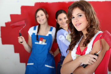 trio of handygirls painting room red