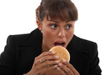 Businesswoman biting a burger