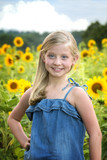 Beautiful little girl in front of sunflower field