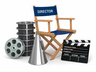 Movie industry. Producer chair, ñlapperboard and film reelsl.