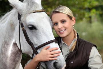 Blond woman with her horse