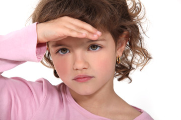 Young girl shading her eyes