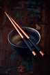 Ceramic bowl and wooden chopsticks