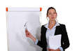 Businesswoman stood in front of flip chart