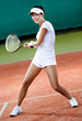 Professional female player at the clay tennis court