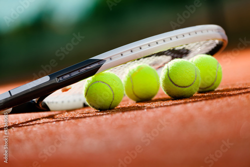Close up view of tennis racket and balls