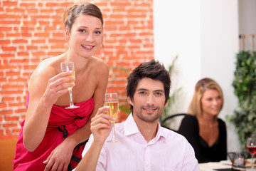 Smart couple drinking champagne at a party