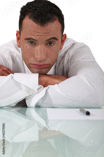 bored businessman sitting at his desk