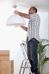 Man putting up a ceiling light