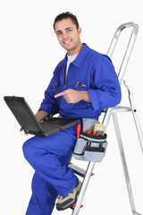 plumber with tools and laptop
