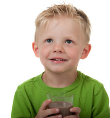 Young boy with chocolate milk on white