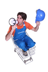 worker seated in cart shouting in loudspeaker