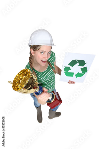 woman holding a cup and a sign with recycling symbol