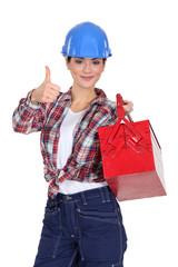 Tradeswoman holding a toolbox