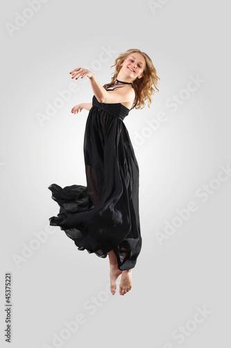 Plexiglas Young female dancer jumping
