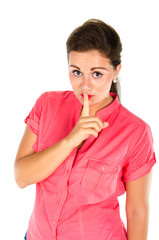 Young woman with one finger on her lips