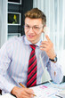 Successfull young business man speaking on the phone
