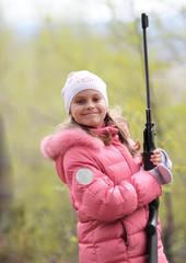 little girl with sport gun