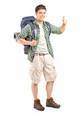 Male hiker with backpack giving a thumb up
