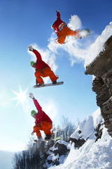 The whole jump of Snowboarder from the rock in mountains
