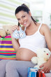 pregnant woman has bought things for your baby