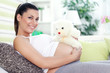 Pregnancy with teddy bear