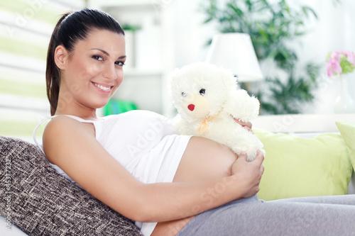 Pregnancy with teddy bear