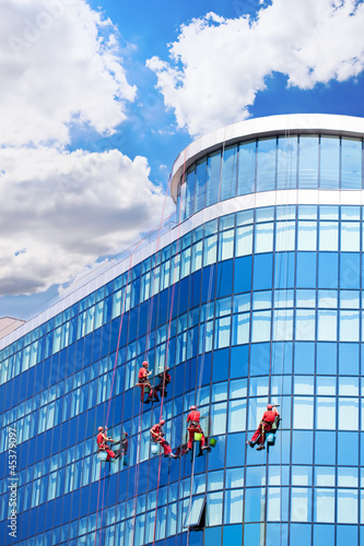 Workers washing windows