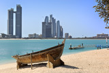 Wooden boat at the Heritage Village, in front of the Abu Dhabi s