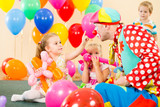 Fototapety happy children and clown on birthday party