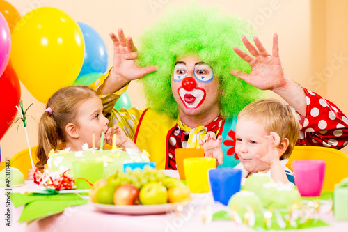 happy kids with clown on birthday party
