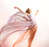 Fototapety Beautiful Girl in blowing Dress Flying